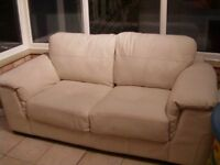 White/off white 2 seater leather sofa