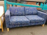Light blue fabric two seater sofa
