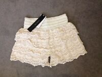 Brand new cream shorts size small