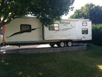 2011 Wildwood Xlite 28BHX trailer with bunks!