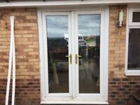 UPVC double doors white 1495mm (has 2x 20mm spacers) wide or 1455mm. Height 2700mm