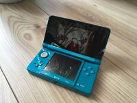 Nintendo 3DS aqua blue with over 200 games