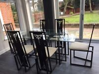 Contemporary Glass and Black Iron Dining table and 6 matching chairs