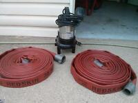 1/2 HP Flotec sub pump and 2x 50 ft length of Red skin Hose