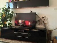 Black gloss tv unit with the top