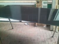 big black glass table , in good condition