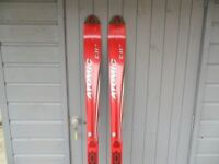 NEW AND UNUSED ATOMIC BETA CARVING SKIS - 180CM IN LENGTH (no bindings)