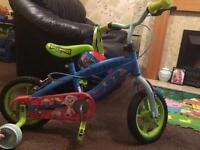 Toy story bike with stableisers and helmet