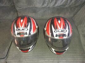 2 motor cycle helmets