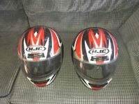 2 motor cycle helmets