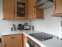 Two bedroom fully furnished ground floor flat with large decking area to the rear and garage nearby