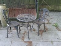 Cast iron love set garden table and chairs