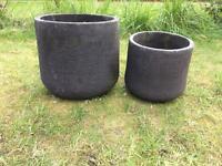 Set of black terracotta garden plant pots