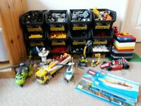 Assortment of lego sets and loose bricks with manuals and storage trays