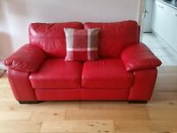 High quality Red leather 2 seater sofa. Light use.