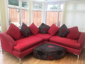 DFS CORNER SOFA RED AND BLACK WITH FOOTSTOOL