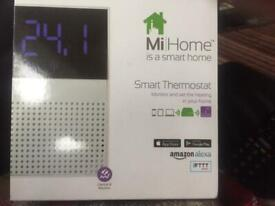 MiHome Smart thermostat and emergence gateway.