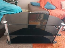 Imacculate black glass tv stand, selling due to not being big enough for a new tv