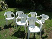 6 White plastic garden chairs