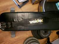 Bodysolid utility bench and olympic weights