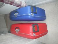 Two Samsonite pull along suitcases.
