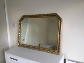 Large gold rimed mirror