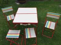 Folding picnic table with chairs and stools