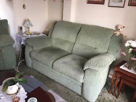 Green two seater sofa and elelectric reclining chair