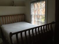 Lovely wooden Double Bed with sleigh style ends.