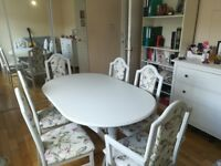 Shabby chic table with 4 chairs and 2 carvers.