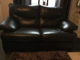 three and two seater sofa chocolate brown double recliner slight damage to the three must collect