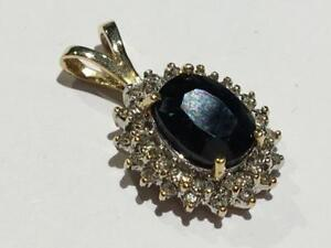#131 14K YELLOW GOLD DIAMONDS SURROUNDING BEAUTIFUL OVAL SAPPHIRE PENDANT. APPRAISED AT $2200.00 SELLING FOR $525.00!