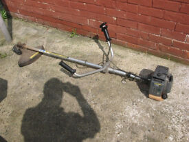 McCulloch TD 4100 Titan heavy Duty petrol strimmer for spares or repairs. Starts and runs and cuts