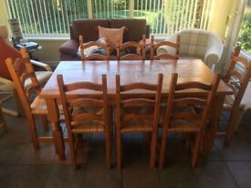 Dinning table and 8 matching chairs.
