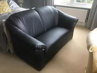 Black leather effect two seater sofa