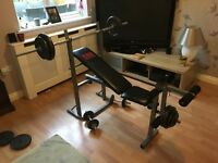 Weight training bench, weights and bars.