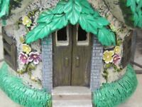 Solar powered garden fairy home.