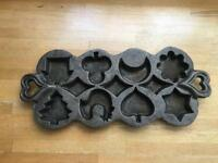 Quirky cast iron muffin pan