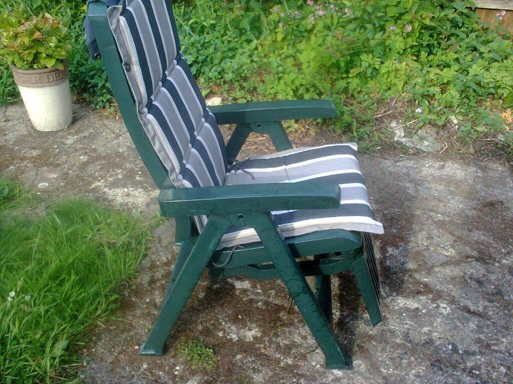 A green plastic reclining garden chair with cover | in ...