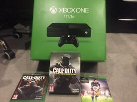 Boxed 1TB Xbox one console with 3 games