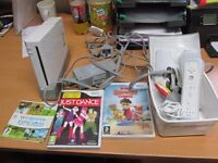 Wii Console with one handset, 2 nunchucks and some games
