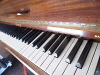 small upright piano by leswein -- also required--
