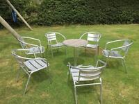 Aluminium table and 6 stackable chairs
