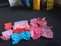 2 bundles of baby clothes