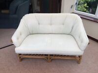 Conservatory cane furniture – three piece with light green cushions