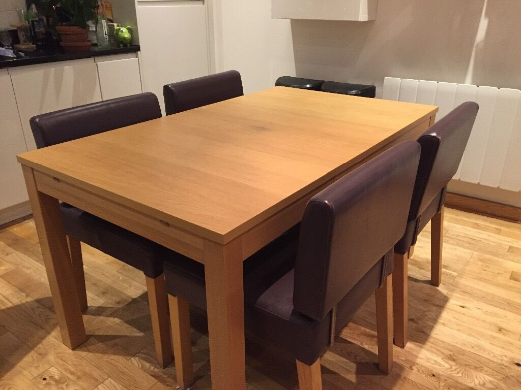 Ikea bjursta extendable wooden dining table in oak veneer for Table ikea 4 99