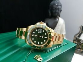 new boxed & bagged gold strap green face rolex submariner