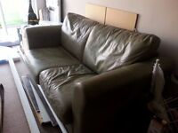Green leather pull out sofa bed