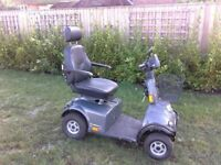 M1 Mini Crosser Mobility Scooter, grey c/w charger and loading ramps, little used