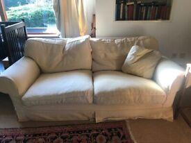 2 cream sofas